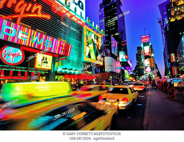 times square new york city at night with light streams