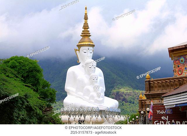 Five white sitting Buddhas are a landmark. View from the entrance towards the main temple. It is called Wat Pha Sorn Kaew, in Khao Kor, Phetchabun, Thailand