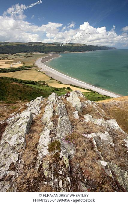 View of coastline looking from coast path on Hurlstone Point, with Worthy Wood and Porlock Common on distant hills, Bossington Beach and Porlock Weir