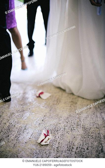 Bags of rice left on the floor of marriage outside the church