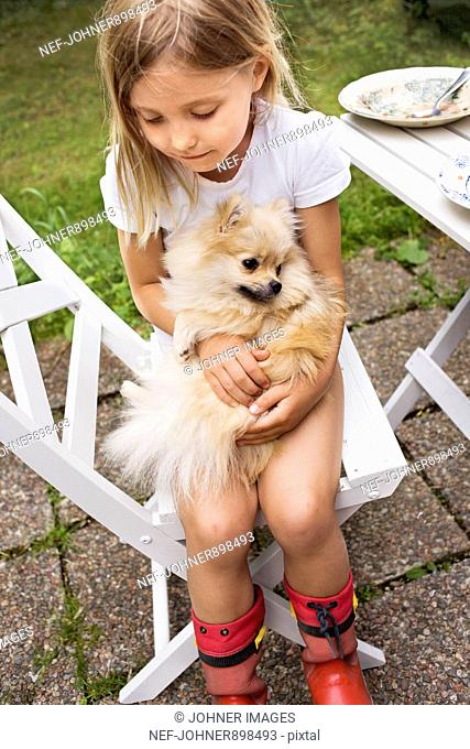 Girl with a dog on her lap, Sweden
