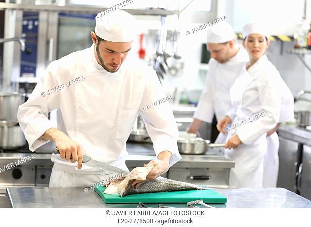 Chef cutting cod, Cooks in cooking school, Cuisine School, Donostia, San Sebastian, Gipuzkoa, Basque Country, Spain, Europe