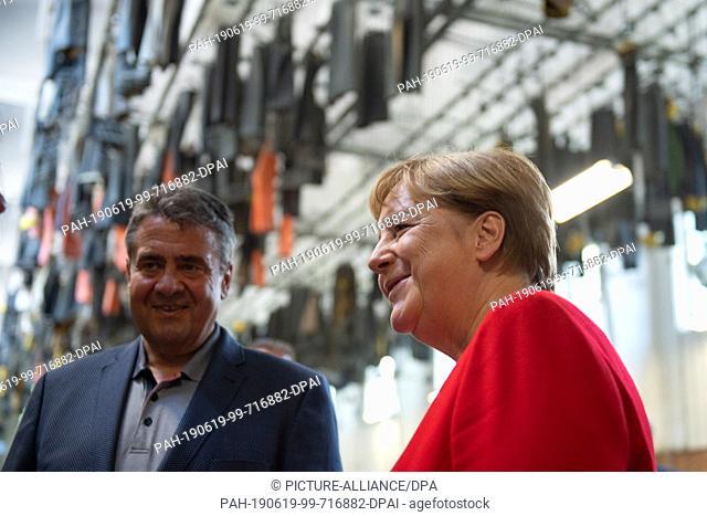 19 June 2019, Lower Saxony, Goslar: Federal Chancellor Angela Merkel (CDU) and Sigmar Gabriel (SPD), honorary citizens of the city of Goslar
