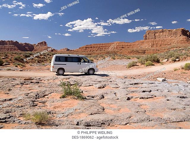 utah, united states of america, a mini-van driving through the valley of the gods