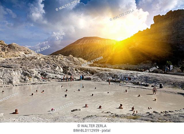 People bathing in hot springs, Isle Vulcano, Sicily, Italy