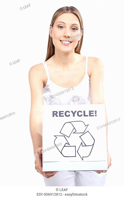 Young happy woman holding recycling waste box