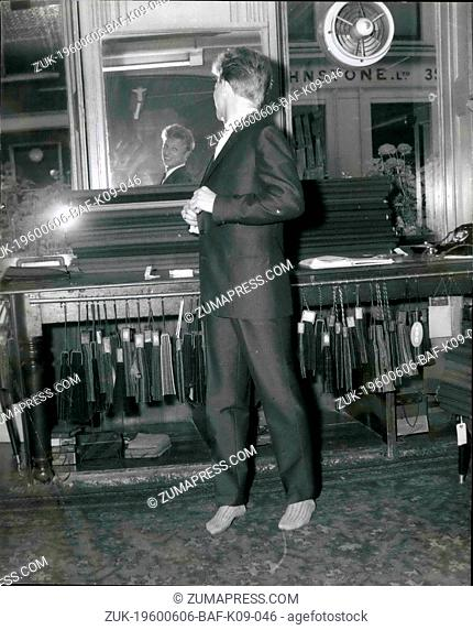 Jun. 06, 1960 - Tommy Steele chooses a cool suit for his wedding tomorrow: Tommy Steele will not be in topper and tails for his wedding tomorrow to showgirl Ann...