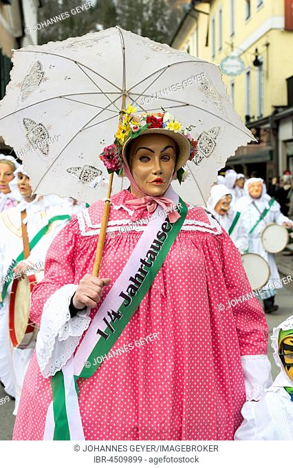 Aussee Carnival, Man with mask, called Dudl, straw hat with flowers, parasol, Trommelweiber, Bad Aussee, Styria, Austria