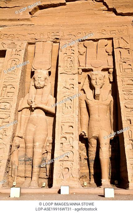 Statues of queen Nefertari and pharaoh Ramesses II on the outer facade of the Small Temple of Hathor at Abu Simbel in Egypt