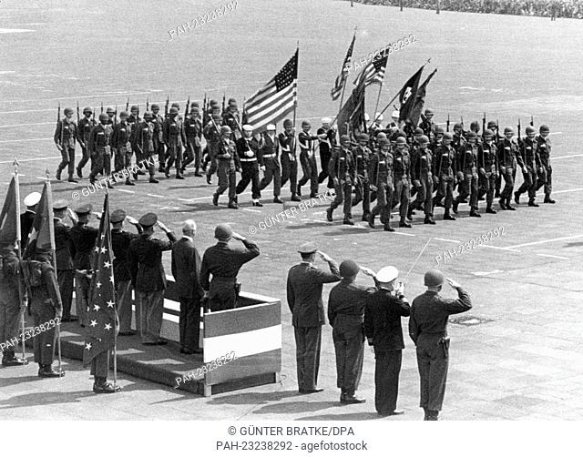 American soldiers marching during a parade on occasion of the 'Armed Forces Day' in front of a VIP stand at airport Tempelhof in Berlin on 18th May 1957