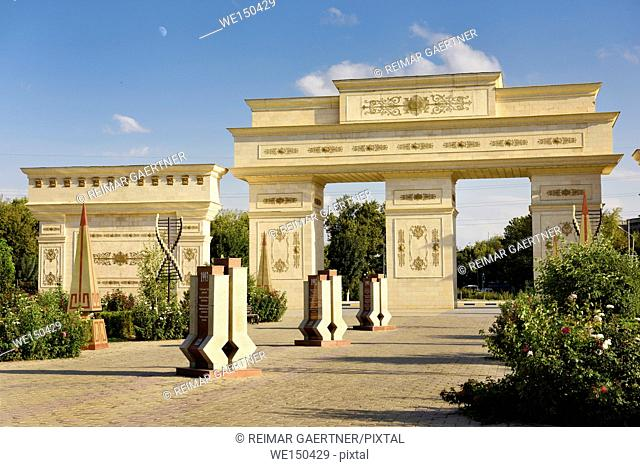 Ornate gates to Independence Park Shymkent Kazakhstan with granite steles with 20 years history 1991 to 2011