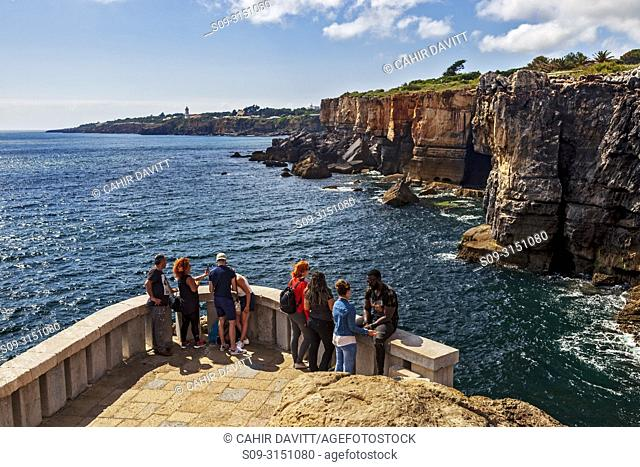 Tourists at the Boca do Inferno viewpoint, looking out over the Tagus River Estuary, Cascais, Lisboa, Portugal
