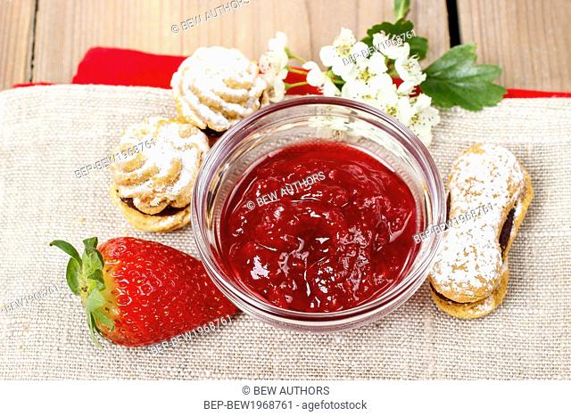 Bowl of strawberry jam. Party dessert