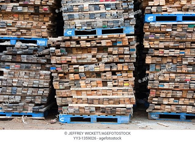 Stacked boards at recycling business, Michigan, USA