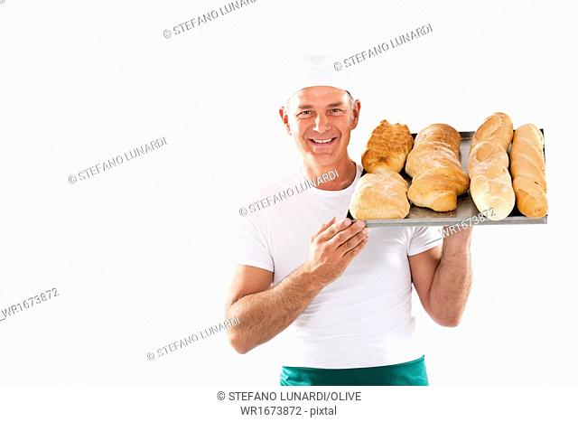 Baker holding tray with bread