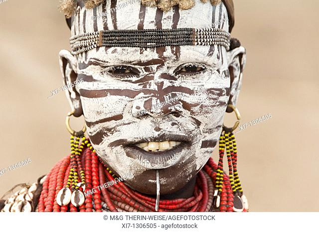 Portrait of a Karo woman with facial paintings and lip piercing, Omo river valley, Southern Ethiopia