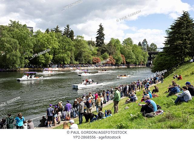 Seattle, Washington: Spectators gathered on the shore of West Montlake Park at the Windermere Cup Crew Race during Opening Day of Boating Season