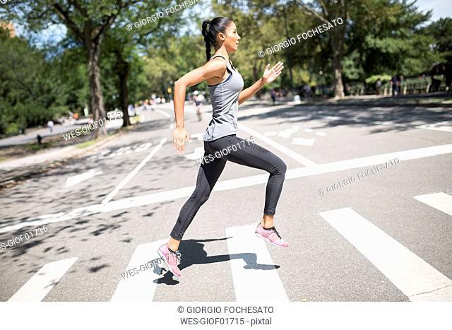 Woman running on zebra crossing