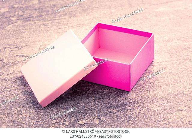 Cardboard package container for a present, colorful gift boxes, Concept of celebration, birthday or event. Simple and clean packaging picture to be used as...