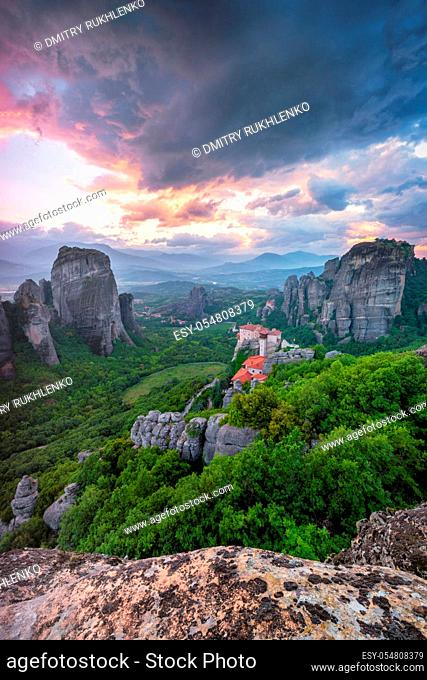 Sunset sky and monastery of Rousanou and Monastery of St. Nicholas Anapavsa in famous greek tourist destination Meteora in Greece with dramatic sky