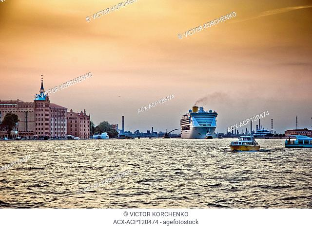 Cruise ship leaving Venice at sunset