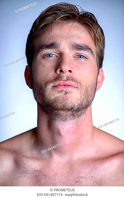 Portrait of a brutal handsome man with naked torso. Male beauty, health