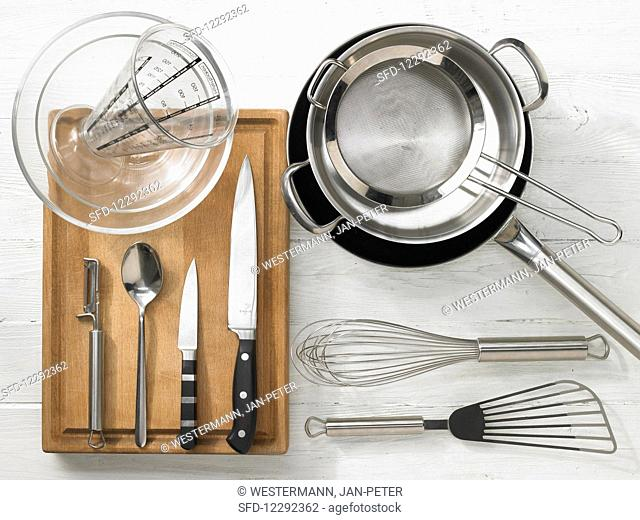 Kitchen utensils for making a pasta and vegetable salad with fish