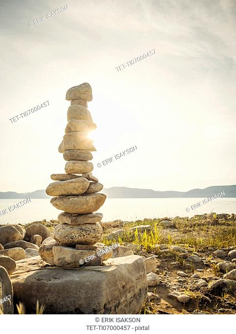 Stack of stones by lake