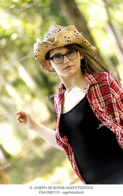 Portrait of a 26 year old woman outdoors on a country road