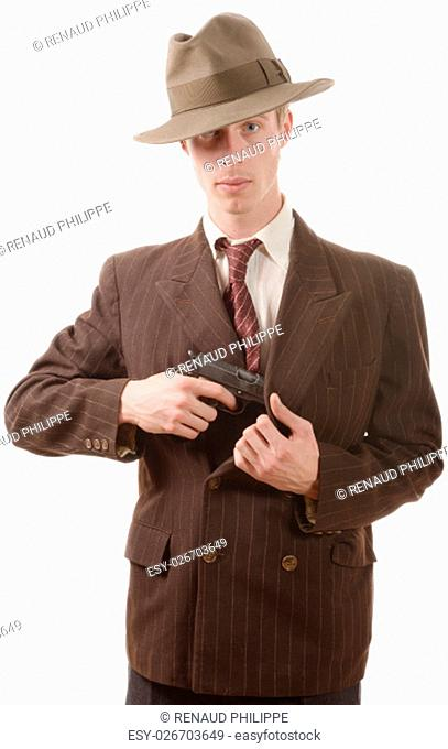 a gangster in a suit vintage, with handgun on white background
