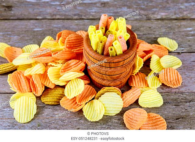 corn chips with spices in wood bag on wooden background
