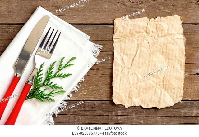Festive table setting with paper on wooden background