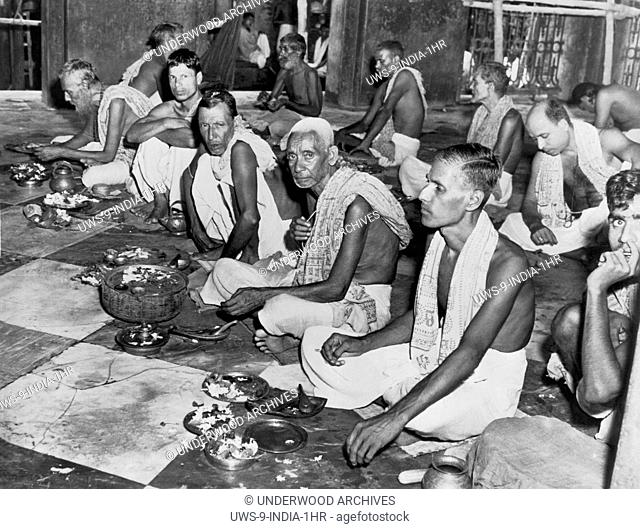 Kalighat, India: c. 1948.Brahmins worship in the Kalighat temple. Brahmins are the highest caste of HIndus, with their mark of distinciton being the piece of...