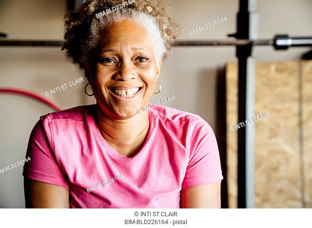 Black woman smiling in garage