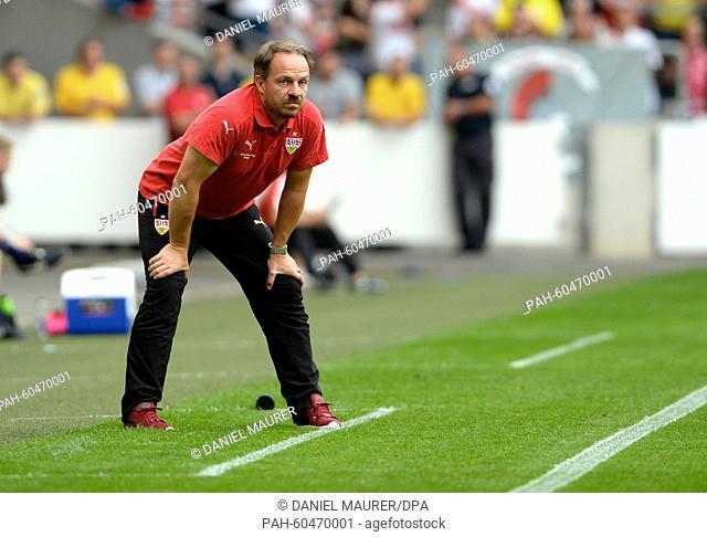 Stuttgart's coach Alexander Zorniger watches the game during a friendly match between VfB Stuttgart and Manchester City at the Mercedes-Benz Arena in Stuttgart