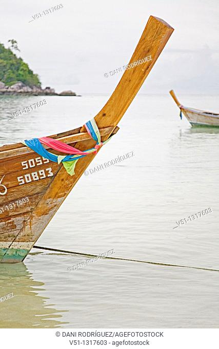 Traditional boats in a paradise beach in Koh Lipe, Thailand