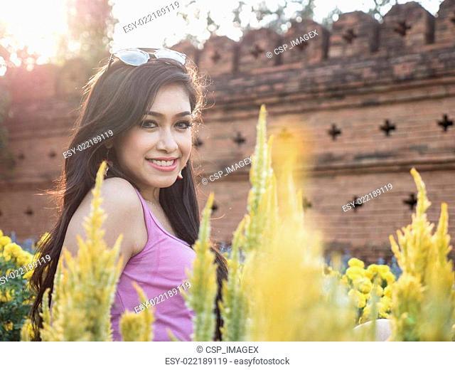 Asian Brunette Model Posing in Natural Setting