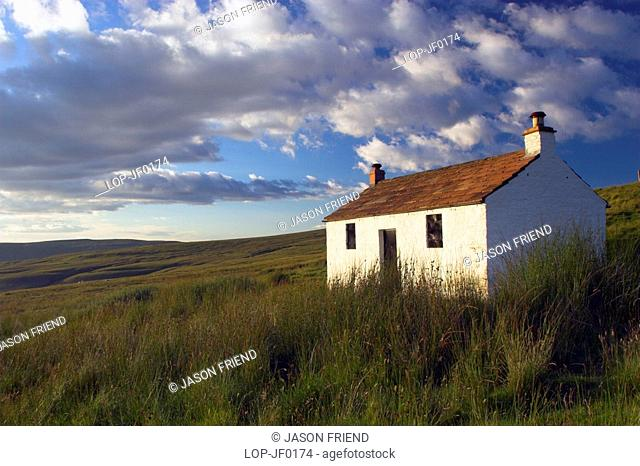 England, Cumbria, Alston, A small cottage located within the barren landscape of Hartside Pass near Alston