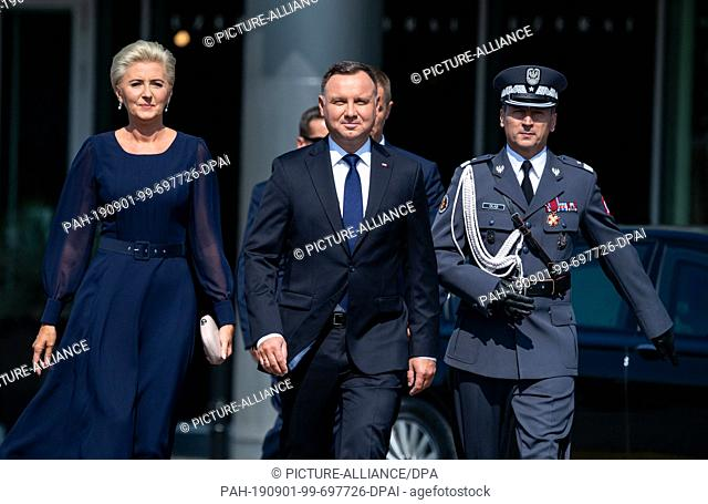 01 September 2019, Poland, Warschau: The Polish President Andrzej Duda (M) and his wife Agata Kornhauser-Duda come to the central commemoration ceremony of the...