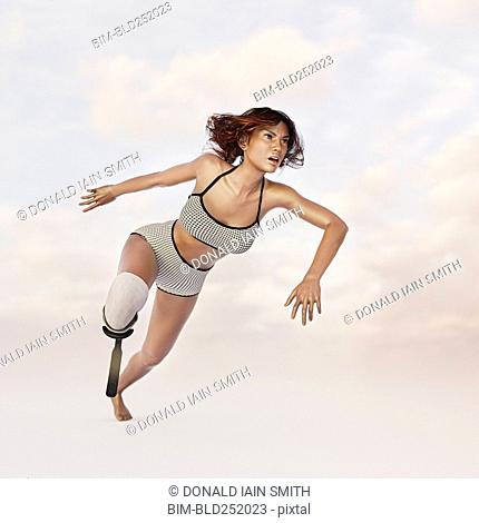 Woman running with artificial leg