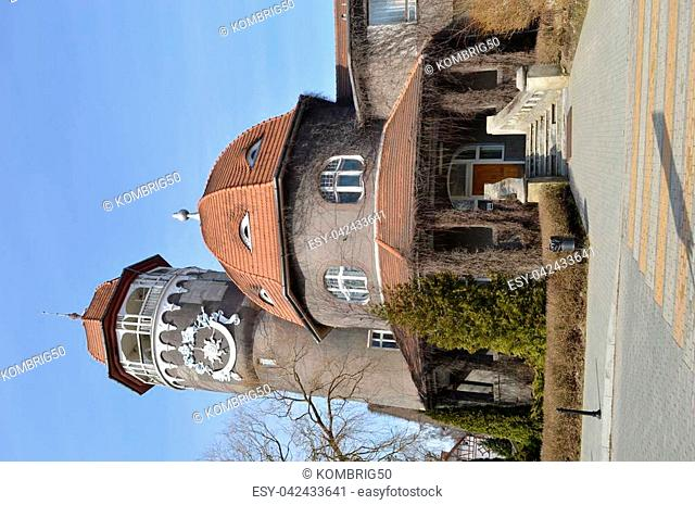 in the city center there is an old water tower, architecture, attraction