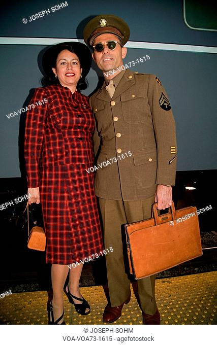 1940's Serviceman and wife pose in front of Pearl Harbor Day Troop train reenactment from Los Angeles Union Station to San Diego