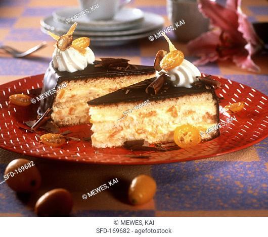 Cream gateau with kumquats and chocolate icing