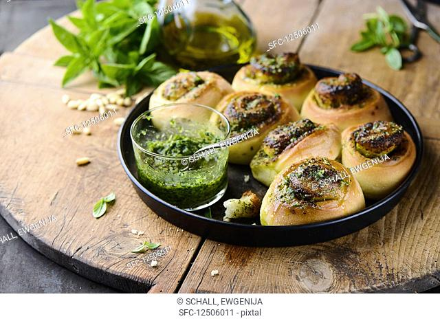 Pesto buns on a wooden board