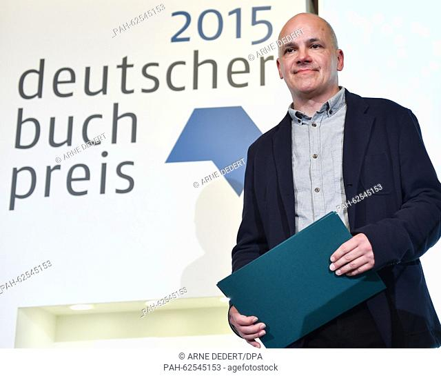 Author Frank Witzel stands on stage with the German Book Prize 2015 in Frankfurt am Main,  Germany, 12 October 2015. This is the 11th time the prize for the...