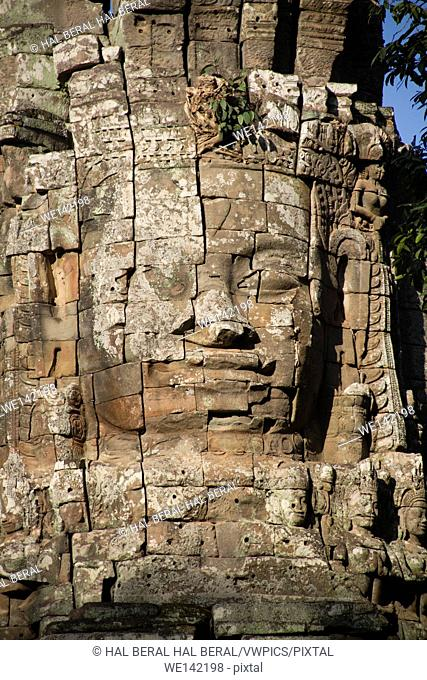 Carved stone face decorates the The Bayon temple complex. Angkor Wat, Cambodia