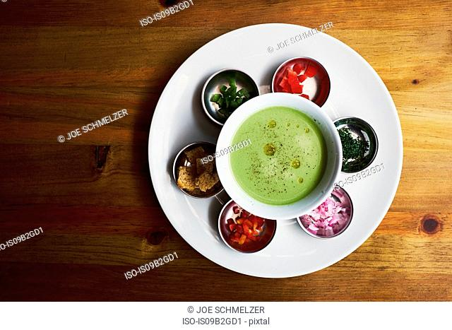 Overhead view of bowl with dipping sauce and chopped vegetables, Antigua, Guatemala