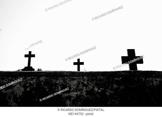 Three crosses in a cemetery