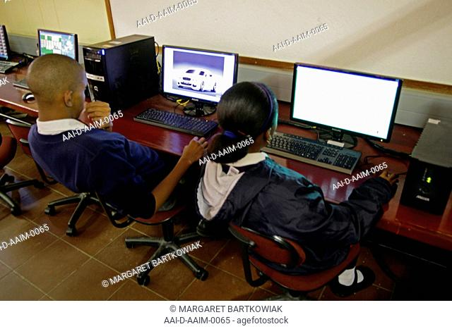 Children working on computers in computer classroom, St Mark's School, Mbabane, Hhohho, Kingdom of Swaziland