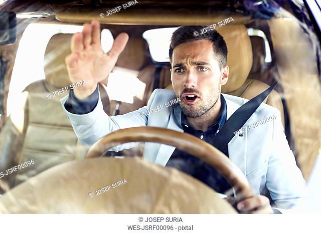 Ranting businessman, driving in his car